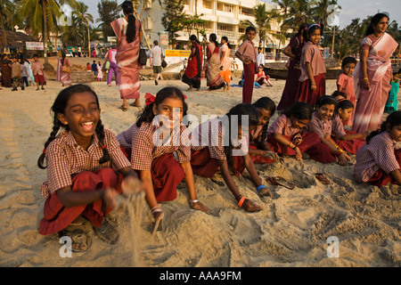 India Kerala Kovalam Group of schoolgirls playing in the sand on Hawah beach 2006 - Stock Photo