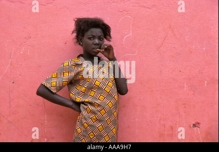 African girl against pink wall in Accra, Ghana - Stock Photo