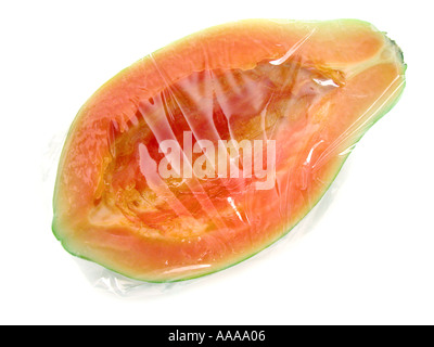 papaya without seeds wrapped in plastic folie sheet Frischhaltefolie cling film plastic wrap preserve serve fresh - Stock Photo