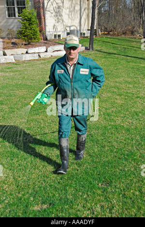 Professional lawn fertilizer and pesticide control applied to a ...