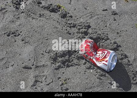 Aluminium can litter on sandy beach Parksville Vancouver Island British Columbia Canada  - Stock Photo