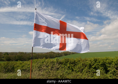 Red cross on a white background The English flag of St George in the Kent countryside England HOMER SYKES - Stock Photo