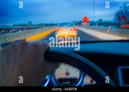 View Of Cars On Highway From Drivers Perspective With Hand On Steering Wheel, Dashboard  And Motion Blur, Philadelphia, - Stock Photo