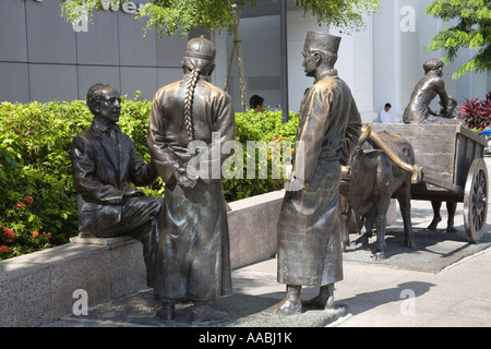 SINGAPORE ASIA May The River Merchants sculpture by Aw Tee Hong on Boat Quay - Stock Photo