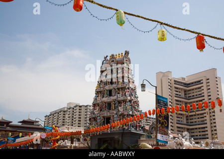 Sri Mariamman Hindu Temple brightly painted Hindu deities on entrance tower or gopuram Chinatown Outram Singapore - Stock Photo