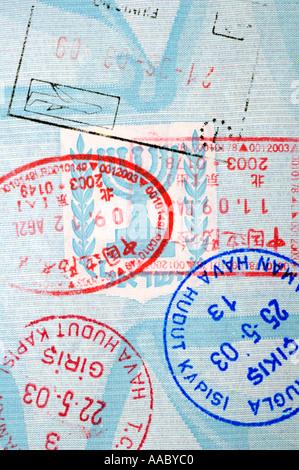 Entry stamps on Israeli Passport - Stock Photo