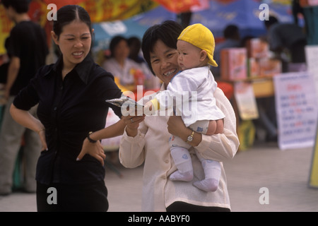 China Hangzhou, Zhejiang Province Mother baby Chinese style children trousers have a bottom opening HOMER SYKES - Stock Photo