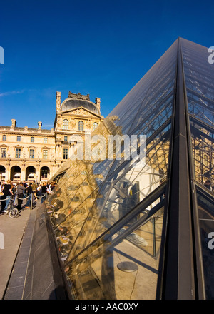 The Denon wing and pyramid at the Louvre museum Paris France - Stock Photo