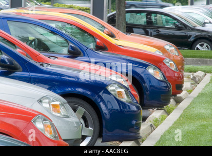 Rows Of New Cars For Sale In New Car Dealership Parking Lot - Stock Photo