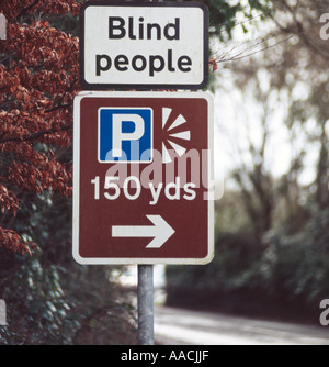 PICTURE CREDIT DOUG BLANE signpost on the Windermere road saying Blind People and a scenic viewing point 150 yards - Stock Photo