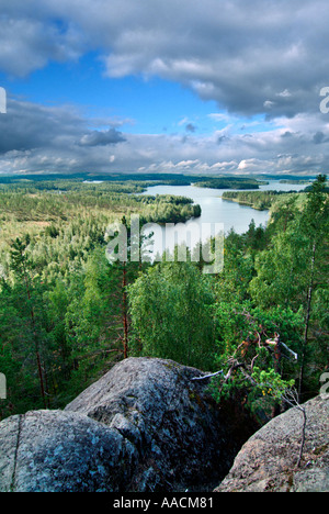 view to landscape with lakes and forests in the region Saimaa in Finland - Stock Photo