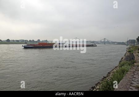 Rhine with freighter near Krefeld-Uerdingen, Krefeld, North Rhine-Westphalia, Germany - Stock Photo