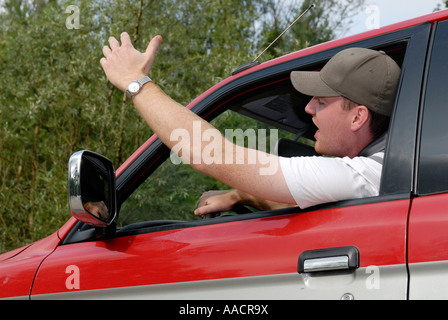 Cardriver makes angry gestures - Germany, Europe. - Stock Photo