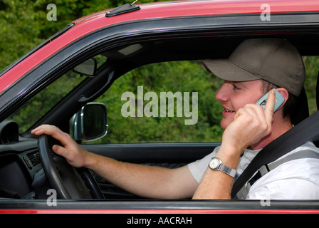 Cardriver with telephone, Germany, Europe - Stock Photo
