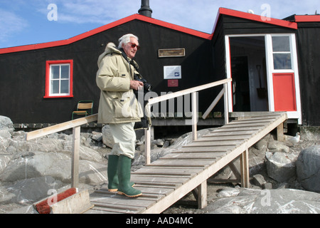 Cruise passenger at the famous Port Lockroy, British Antarctic base and post office on Wiencke  Island - Stock Photo