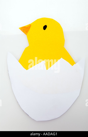 piece of handicraft work papermade paper made white easter egg with yellow chick chicken fledgling EASTER card animal - Stock Photo