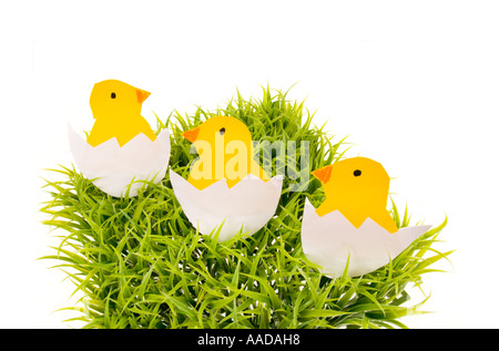 3 three piece handicraft work papermade paper made white easter egg yellow chick chicken fledgling EASTER green - Stock Photo