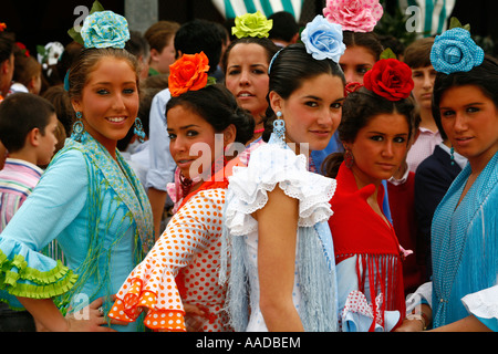 Young women wearing traditional flamenco dress at the April Fair Seville Spain - Stock Photo