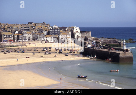 St Ives harbour and beaches at low tide with town beyond - Stock Photo