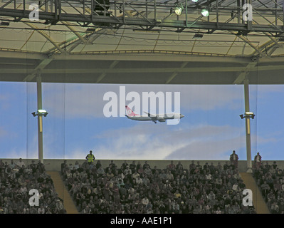 Frankfurt am Main View out of the new Commerzbank Arena An airplane is landing at airport Rhein Main Frankfurt The - Stock Photo