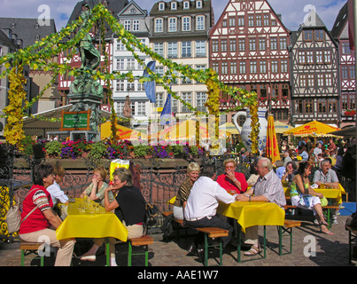 Frankfurt am Main The traditional Main Festival at Roemerberg the East Row of the square the Fountain of Justice - Stock Photo