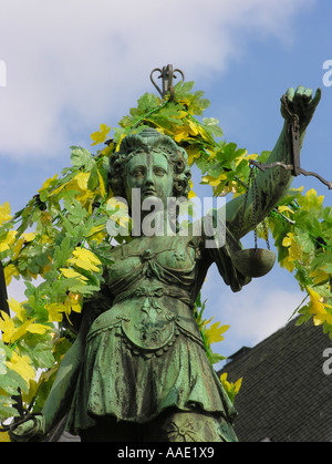 Frankfurt am Main The traditional Main Festival at Roemerberg the decorated Fountain of Justice the bronze figure - Stock Photo