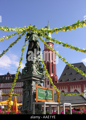 Frankfurt am Main The decorated bronze figure of Justice Fountain of Justice The tower of the St Nikolai Church - Stock Photo