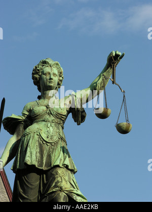 Frankfurt am Main The bronze figure of the Justice with the scales of justice and the sword Fountain of Justice - Stock Photo