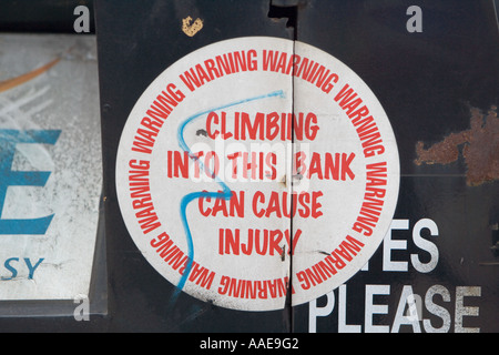 Hazard Notice on recycling container - Stock Photo