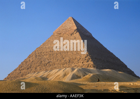 Desert Sands Encroach on The Great Pyramid of Cheops (Khufu), Giza, Egypt - Stock Photo