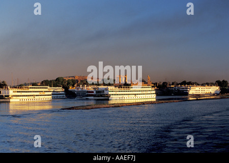 Nile Cruise Ships Await Passengers at Kom Ombo, Egypt - Stock Photo