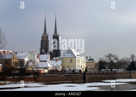 Ostrow Tumski Island and Cathedral of St John Baptist in cold winter light Oder river Wroclaw Breslau Poland - Stock Photo