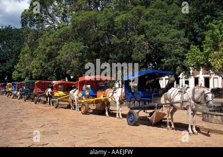 Horse drawn carriages in a row Tiradentes Minas Gerais Brazil - Stock Photo
