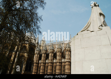 Statue of King George V and Westminster Abbey London England - Stock Photo