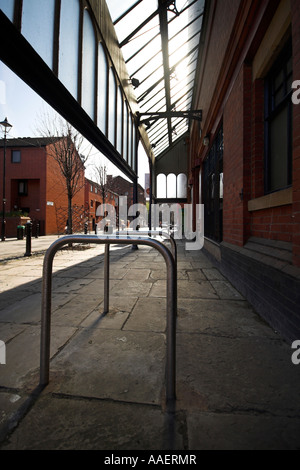 Bicycle stand outside the Manchester Craft Village, Oak street, Northern Quarter, Manchester, UK - Stock Photo