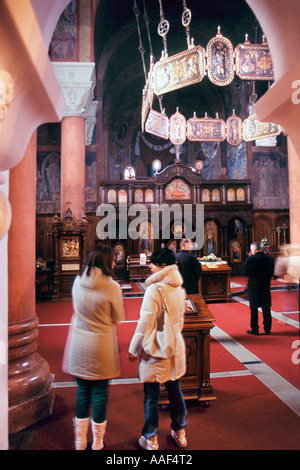 Visiting Believers inside  Serbian Orthodox Cathedral of the Holy Trinity built 1962-1972 in Serb-Byzantine style. - Stock Photo
