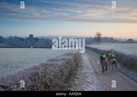 frosty winter morning horse riders on the road to Milborne Port nr Sherborne Dorset England UK - Stock Photo