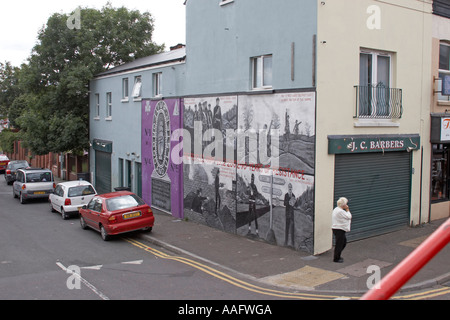 Loyalist Unionist UVF logos murals signs and graffiti on Shankill Road in City of Belfast Northern Ireland UK - Stock Photo