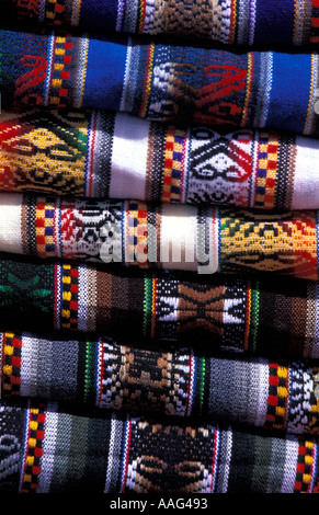 Stack of brightly coloured woven fabrics from Southern Peru For sale at the Colca Canyon near Arequipa South America - Stock Photo