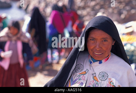 Portrait of a friendly woman from Amantani in costume idiosyncratic to this island Lake Titicaca Peru South America - Stock Photo