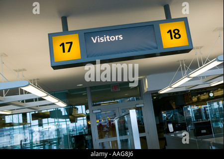 Passport control channels for arriving passengers at Terminal 4 of JFK airport in New York City USA April 2006 - Stock Photo