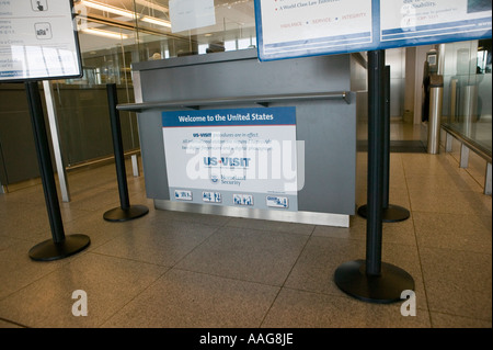 View of a US Visit sign on a passport control booth at Terminal 4 of JFK airport in New York City USA April 2006 - Stock Photo