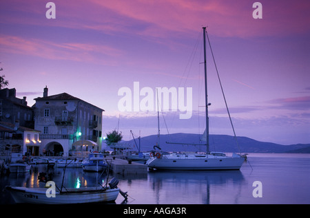 Boats in harbour sunset Valun bay of Kvarner Cres Croatia - Stock Photo