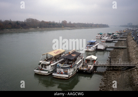 Boats moored on the Danube River across from Margaret Island, Budapest, Hungary - Stock Photo