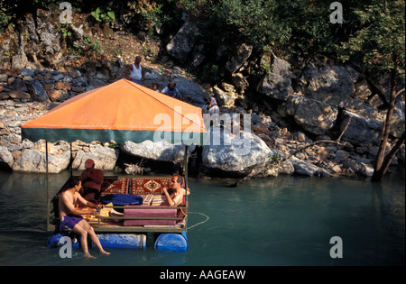 People sitting in pikinik restaurant over the dimcayi for Alanya turkish cuisine
