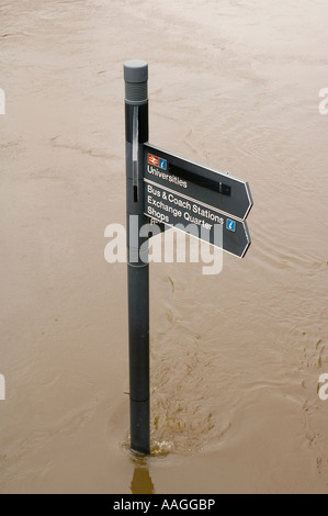 Flooded River Aire submerged footpath sign on tow path at Brewery Wharf, Leeds, West Yorkshire, England, UK 25 June - Stock Photo