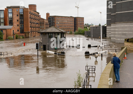 River Aire & Leeds Liverpool Canal had flooded & merged. View of lock at Clarence Dock / Royal Armouries Leeds 25 - Stock Photo