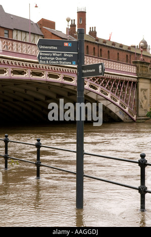 Flooded River Aire submerged sign on tow path at Crown Point Bridge, Leeds, West Yorkshire, England, UK 25 June - Stock Photo