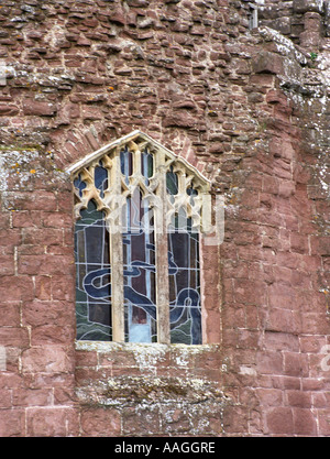 Goodrich Castle in Herefordshire - stained glass window and part of the castle walls showing the effects of weathering - Stock Photo