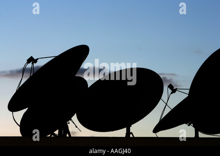 Satelitte antennas on the roof of a sky scraper - Stock Photo